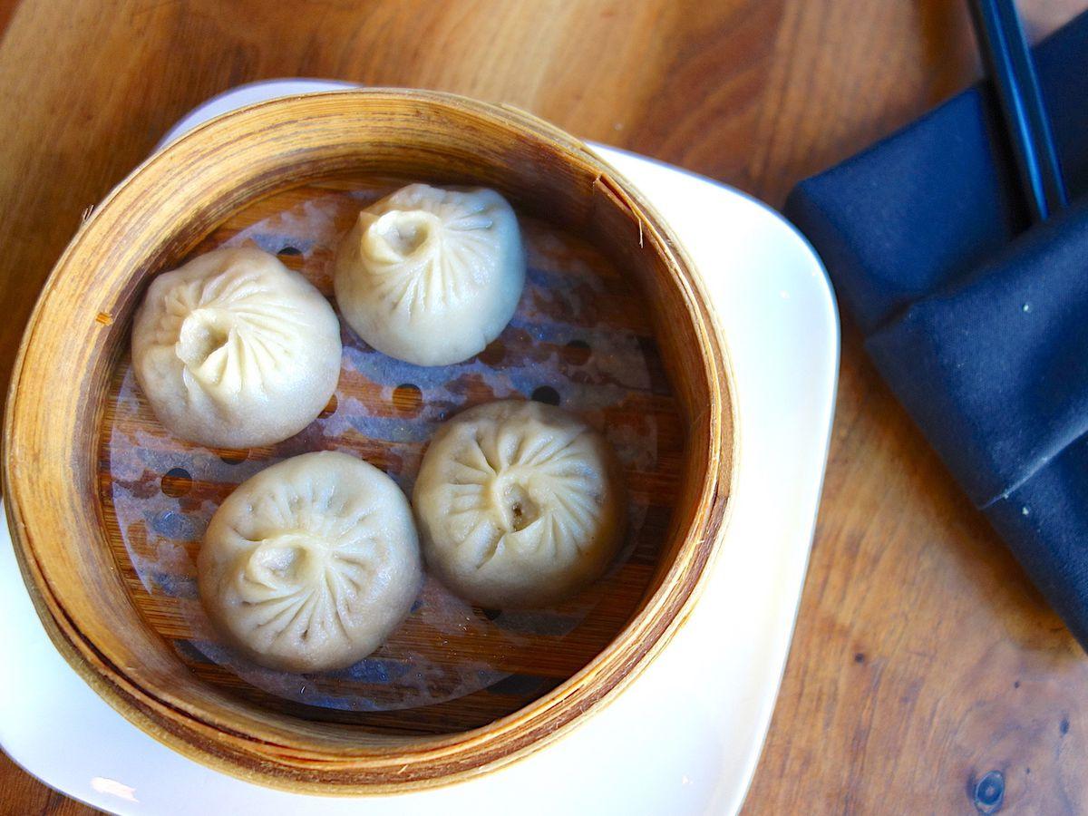 Soup dumplings in bamboo steamer