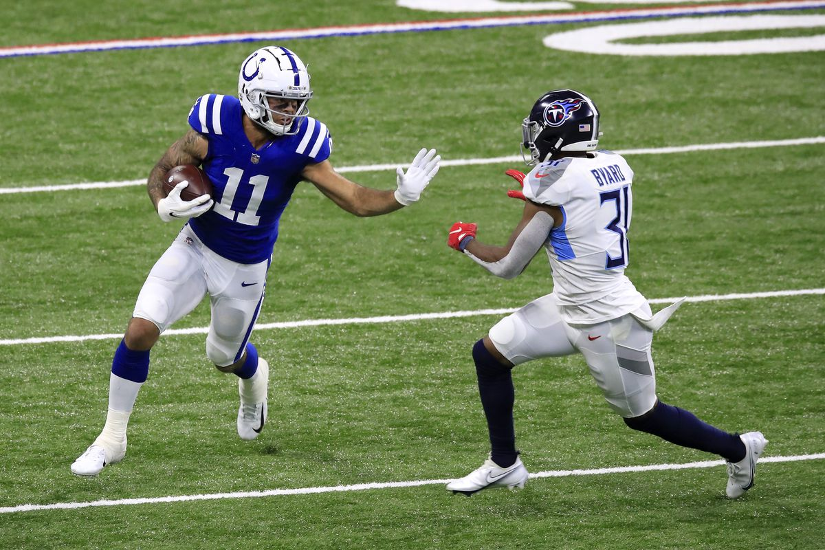 Michael Pittman Jr. #11 of the Indianapolis Colts attempts to break a tackle from Kevin Byard #31 of the Tennessee Titans in the fourth quarter during their game at Lucas Oil Stadium on November 29, 2020 in Indianapolis, Indiana.