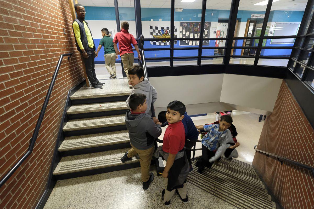 Children near indoor stairs of Thomas Gregg Neighborhood School, one of 26 innovation schools in Indianapolis Public Schools.
