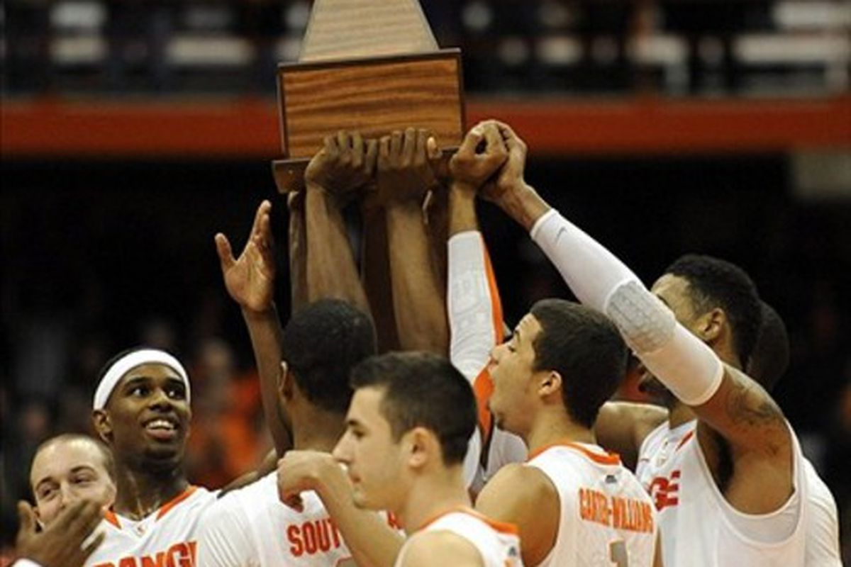 Mar 3, 2012; Syracuse, NY, USA; Syracuse Orange players hoist the Big East regular season championship trophy after the game against the Louisville Cardinals at the Carrier Dome.  Richard Mackson-US PRESSWIRE