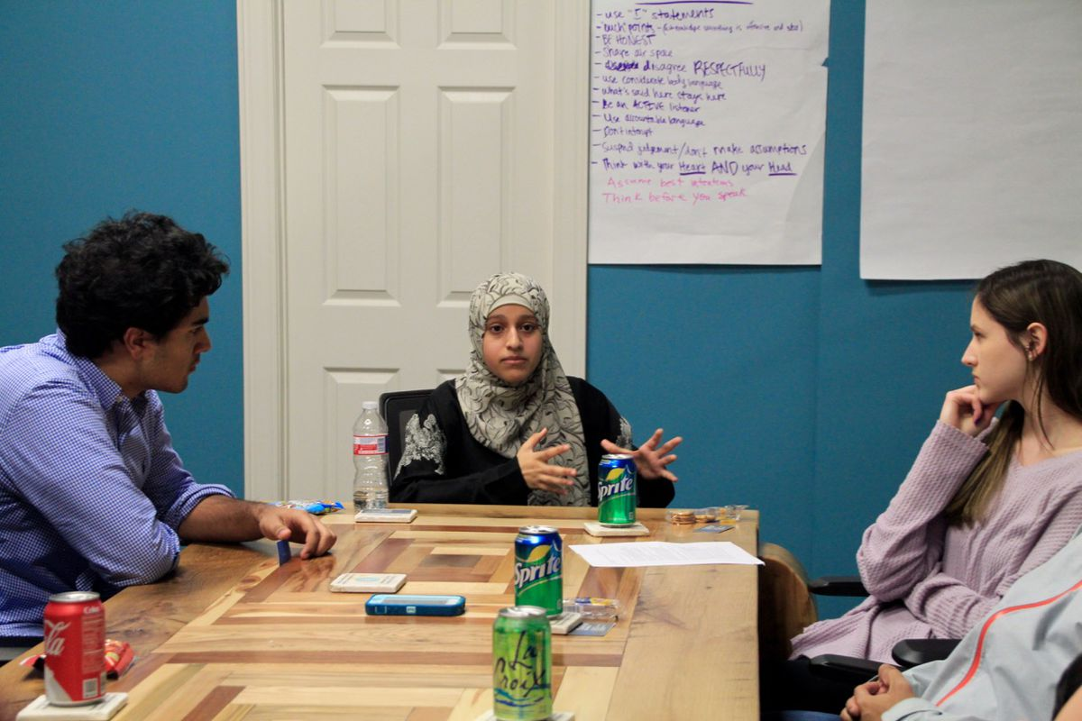Amal Altareb speaks with student leaders from other schools.