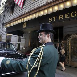 Head doorman Jim Sheehy works outside New York's St. Regis Hotel, Wednesday, March 14, 2012. A century after the Titanic sank, the legacy of the ship's wealthiest and most famous passenger, John Jacob Astor, quietly lives on at the luxury hotel he built in New York City.