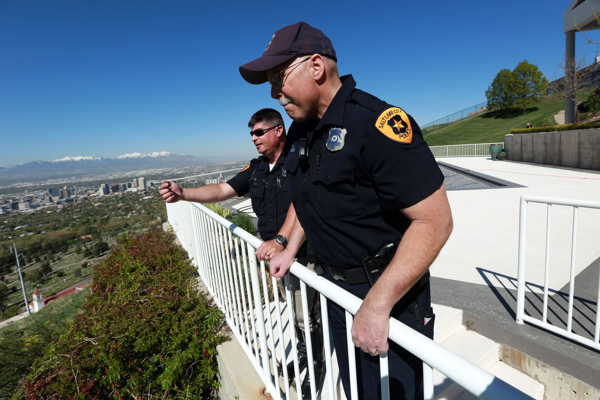 Salt Lake City Police officers look at the area where a boy who has autism spent the night. A new Utah law requires new officers to complete training about autism and mental illness.