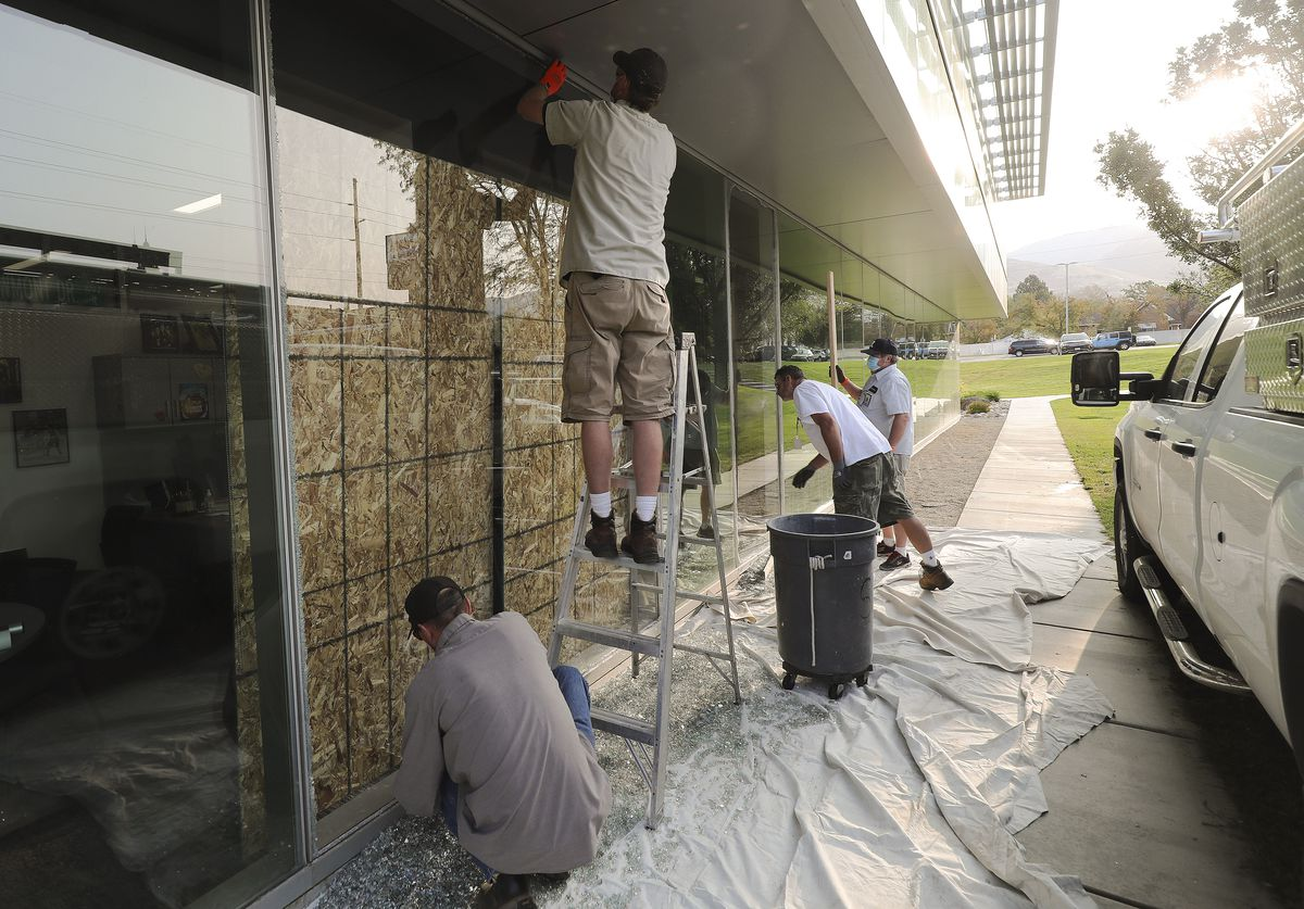 Crews replace broken windows at Viewmont High School in Bountiful on Wednesday, Sept. 16, 2020. Bountiful police say a man who was armed with a rifle, a bow and arrow, and a knife near a the high school was shot and killed by police Tuesday night.