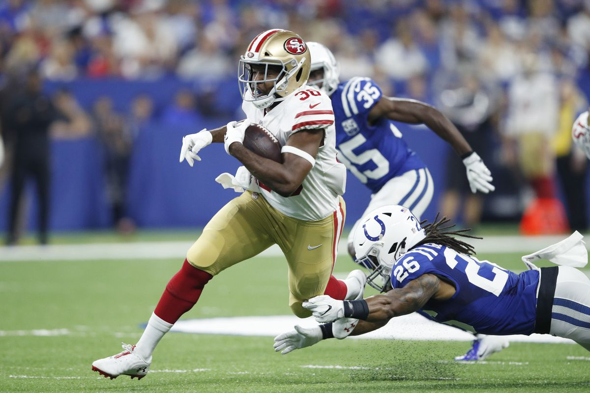 Alfred Morris runs with the ball against the Colts