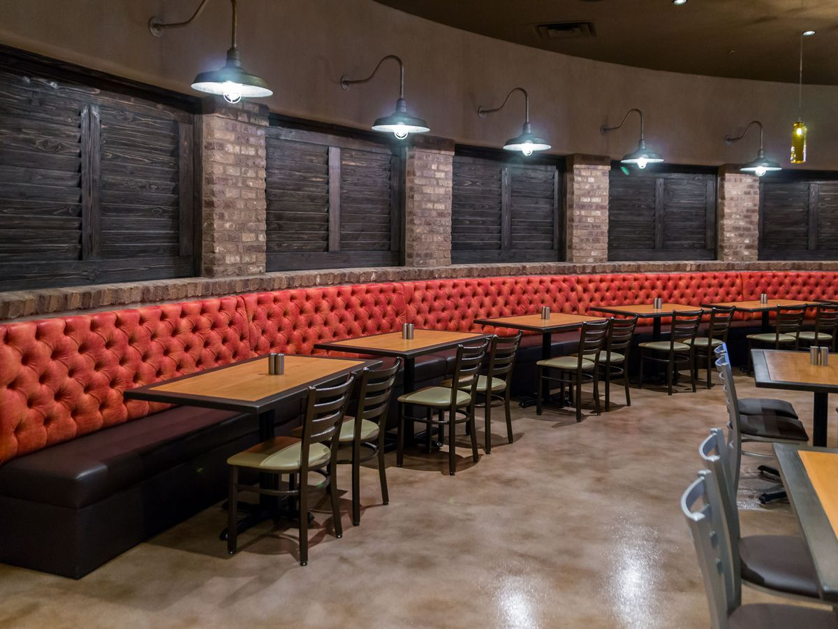 Bar interior with red tufted seating