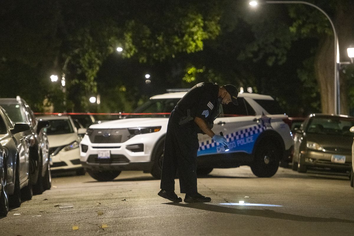 Chicago police investigate Friday evening in the 6500 block of South Ellis Avenue in Woodlawn, where a 4-year-old boy was shot and critically wounded.