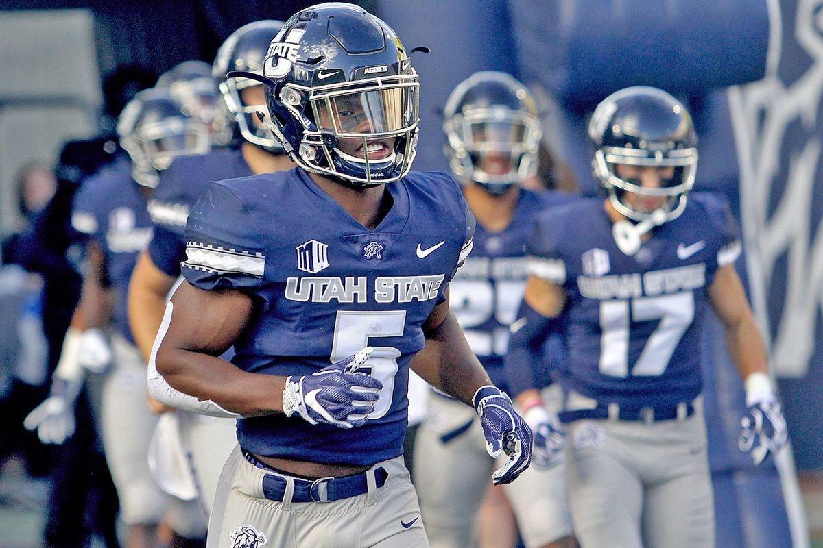 Utah State running back Darwin Thompson (5) runs onto the field prior to the start of USU's game against Tennessee Tech on Sept. 13 in Logan.