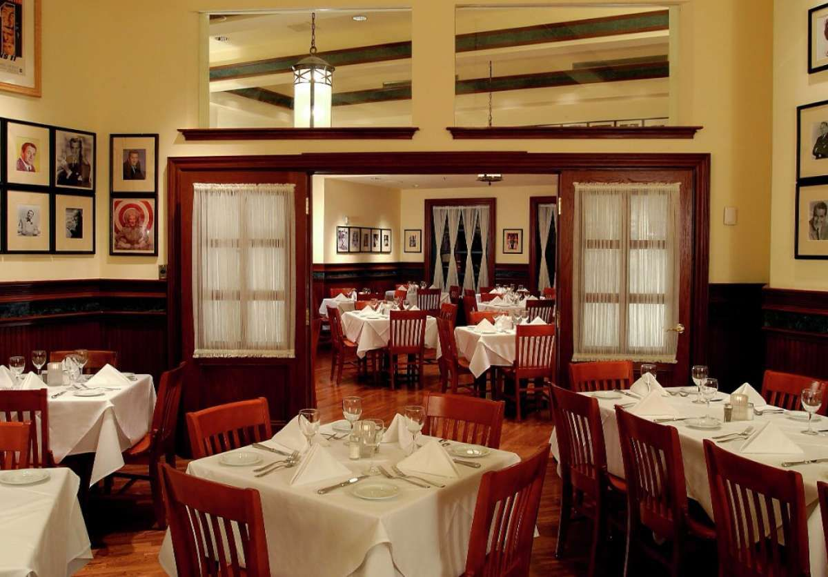 Restaurant dining room with white table cloths