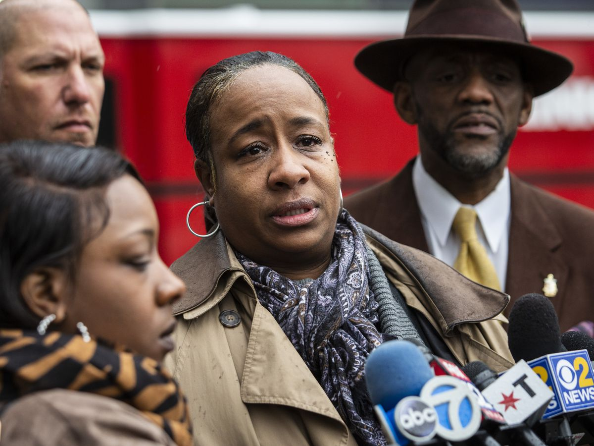 Flanked by family members and supporters, Joslyn Ewing, whose cousin Martina Standley was struck by a Chicago police SUV, speaks to reporters outside the University of Chicago Medical Center on Nov. 19, 2019.