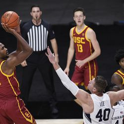 Southern California's Evan Mobley, left, shoots over BYU's Kolby Lee during game, Tuesday, Dec. 1, 2020, in Uncasville, Conn.