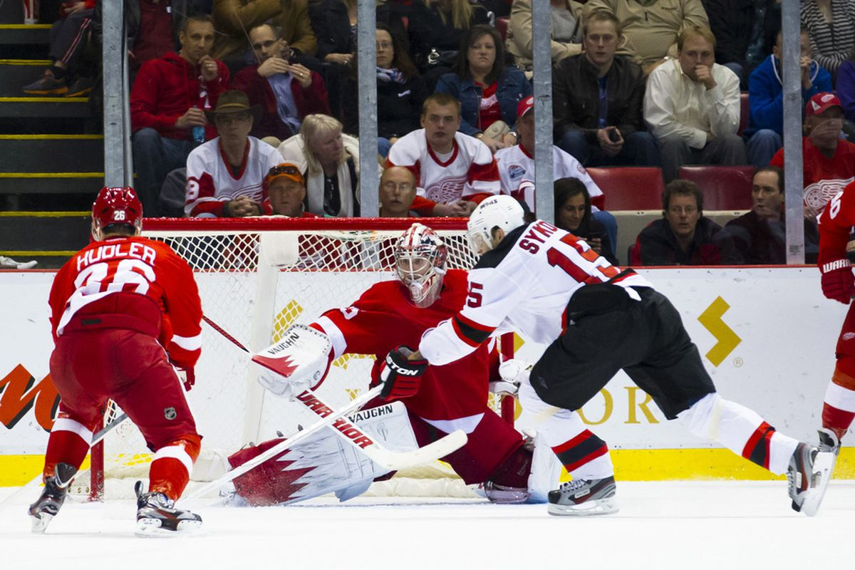 Petr Sykora rounds Jimmy Howard in the third period just to put the New Jersey Devils up 2-1. Mandatory Credit: Rick Osentoski-US PRESSWIRE