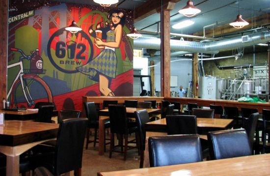 Inside the taproom with an Adam Turmann mural of a girl in plaid holding a platter of beer
