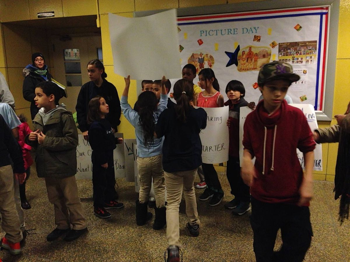 Students joined their parents to protest the board's November vote to return the school's charter at a December meeting.