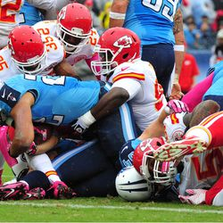 Oct 6, 2013; Nashville, TN, USA; Tennessee Titans running back Jackie Battle (22) is stopped at the goal line by Kansas City Chiefs defensive tackle Anthony Toribio (98) and safety Quintin Demps (35) during the first half at LP Field. The Chiefs won 26-17