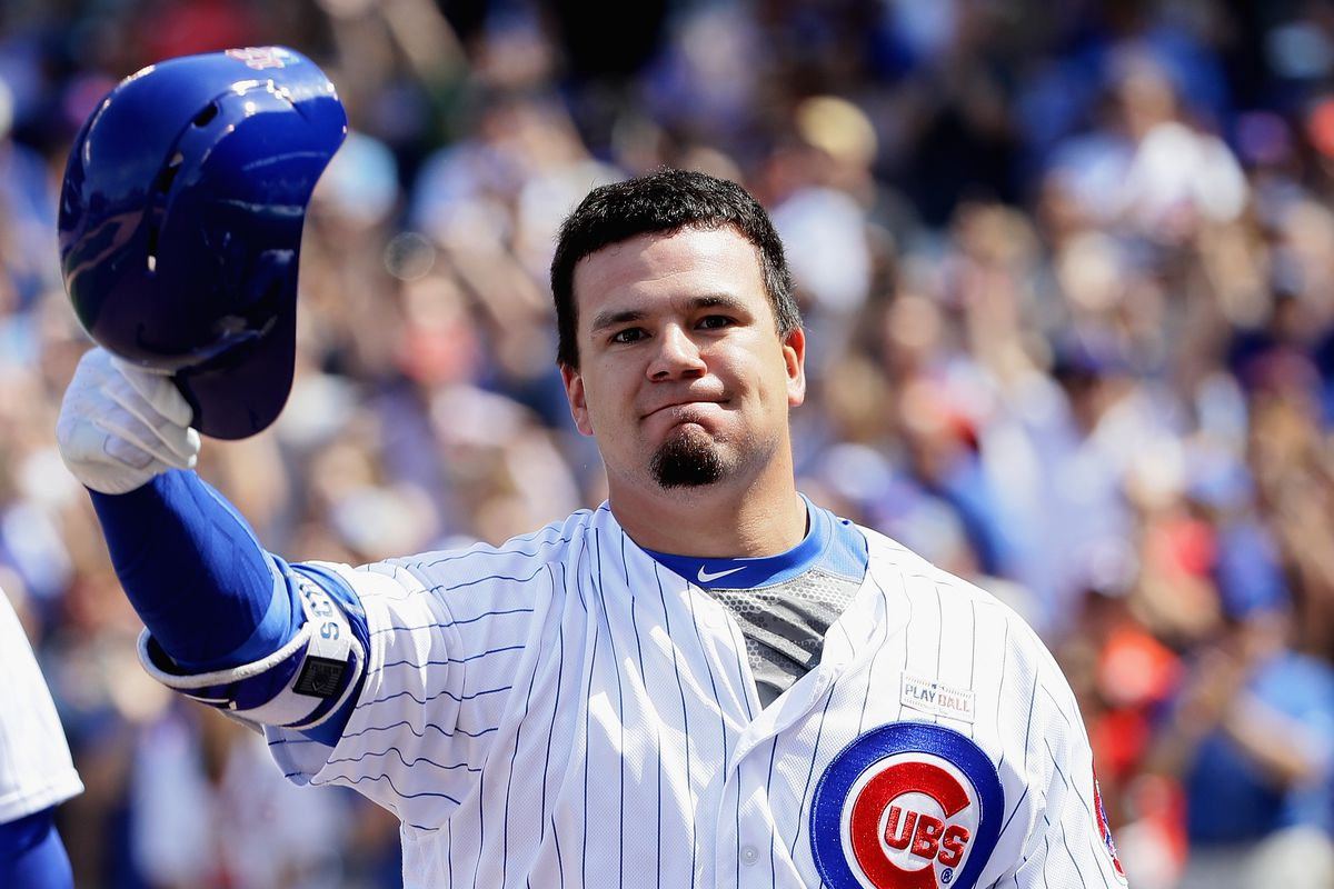 CHICAGO, IL - JUNE 03:  Kyle Schwarber #12 of the Chicago Cubs tips his helmet to the crowd after hitting a grand slam home run in the 7th inning against the St. Louis Cardinals at Wrigley Field on June 3, 2017 in Chicago, Illinois. (Photo by Jonathan Daniel/Getty Images)
