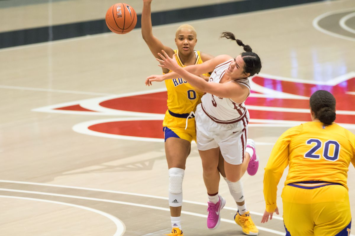 PULLMAN, WA - FEBRUARY 28: Washington State guard Charlisse Leger-Walker (5) throws a desperation shot after contact during the second half of a Boeing Apple Cup Series matchup between the Washington Huskies and the Washington State Cougars on February 28, 2021, at Beasley Coliseum in Pullman, WA.