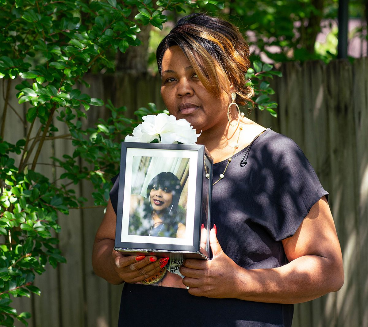It's been more than a year since Cassandra Rollins' daughter Shalondra died of COVID-19, but Rollins says the grief is unrelenting. She'ss now raising Shalondra's two teenage daughters.