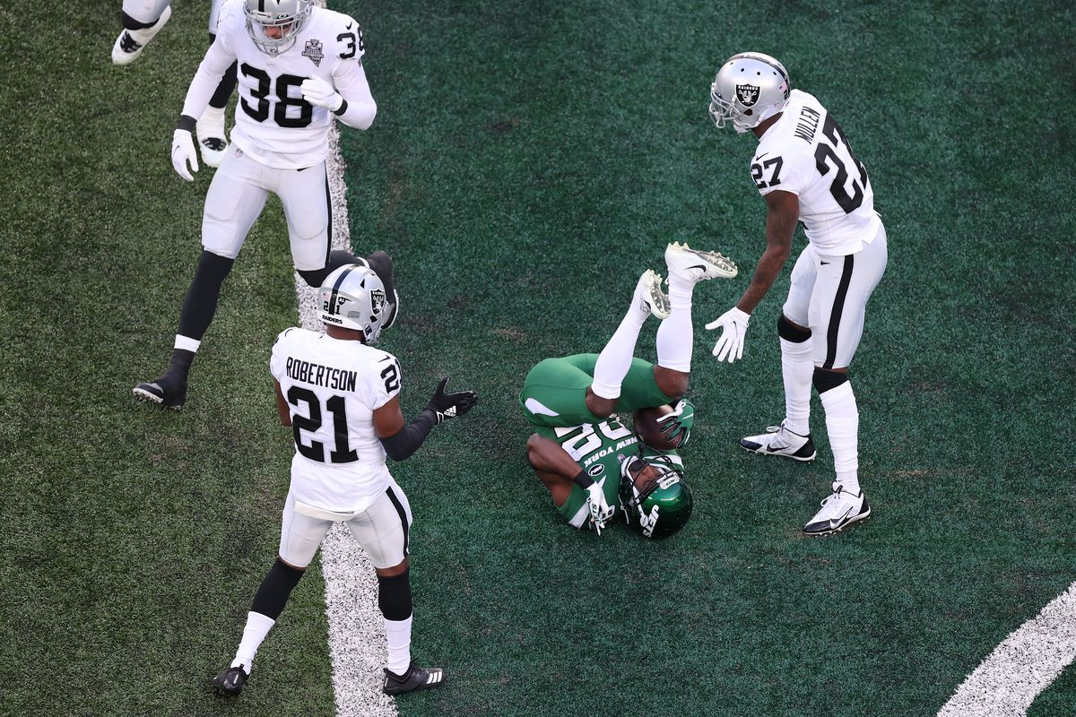 Jamison Crowder #82 of the New York Jets rolls in the end zone after catching his second touchdown pass of the game during the first half against the Las Vegas Raiders at MetLife Stadium on December 06, 2020 in East Rutherford, New Jersey.