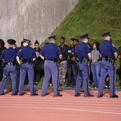 The Michigan State Police keep the protesters at bay