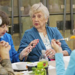 Ione Headman talks with friends while eating lunch at Millcreek Senior Center in Salt Lake City Wednesday, May 21, 2014.