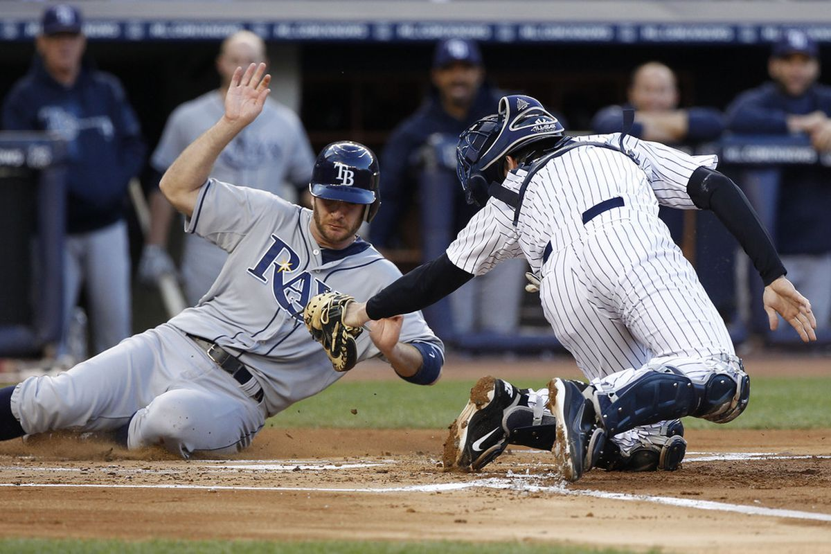 May 10, 2012; Bronx, NY, USA; New York Yankees catcher Chris Stewart (19) tags out Tampa Bay Rays second baseman Jeff Keppinger (7) in 1st inning at Yankee Stadium. Mandatory Credit: William Perlman-The Star-Ledger via US PRESSWIRE