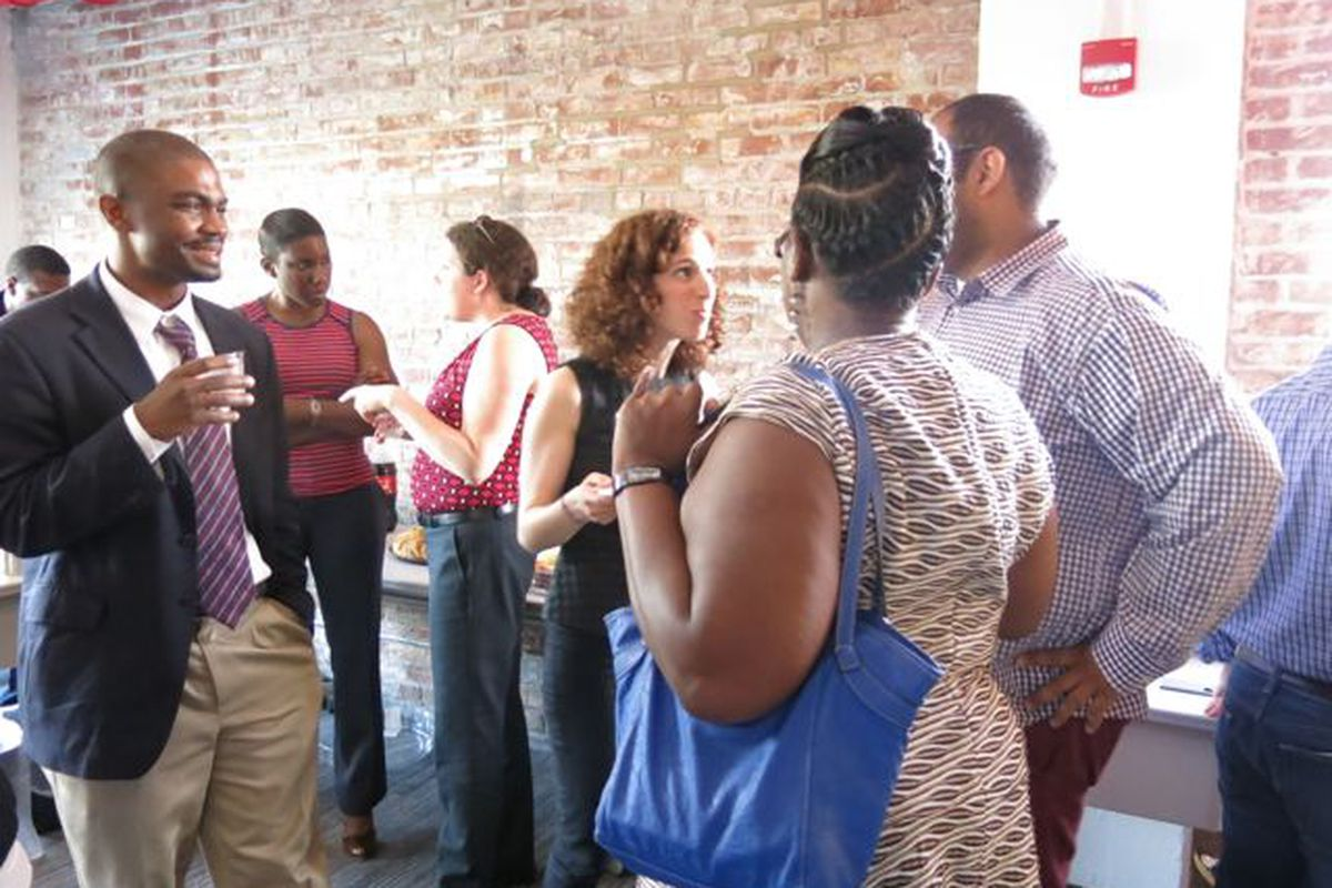 Daarel and Elizabeth chat with guests during the Meet and Greet on May 22.