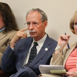 """FILE""""""""Salt Lake County Recorder Gary Ott sits with Chief Deputy Recorder Julie Dole, left, and governmental affairs liaison Karmen Sanone in the county council meeting as members meet and vote on a new nepotism policy during their meeting in Salt Lake City Tuesday, April 26, 2016."""