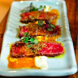 Wagyu Beef Tiradito, parmesan sauce, aji amarillo, vinaigrette, black truffle at Paiche by Darin Dines