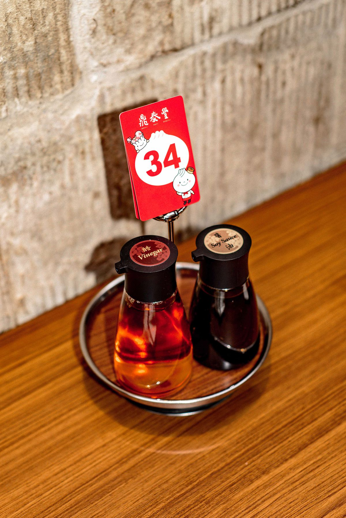 Soy sauce and vinegar for xiaolongbao dumplings at Din Tai Fung's new London restaurant in Covent Garden