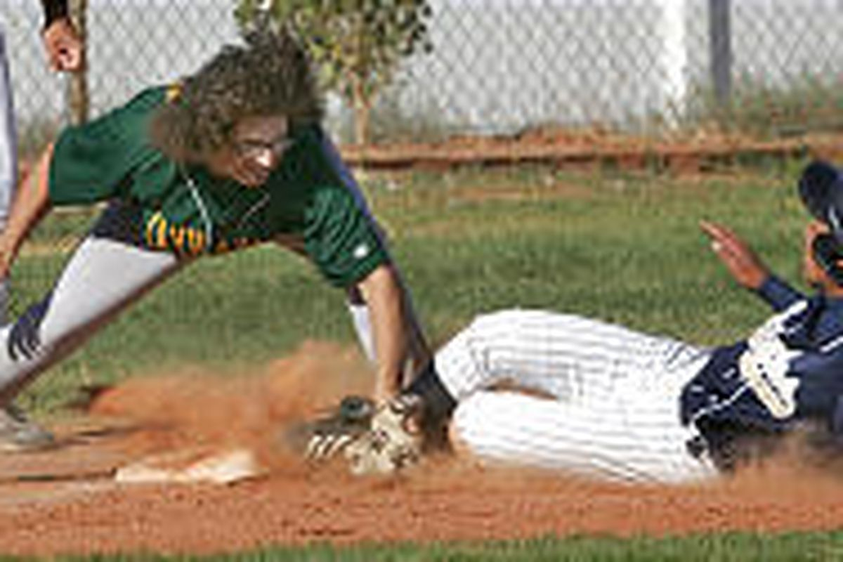 St. Joseph's Oliver Del Carlo applies the tag on West Ridge's Anthony Photesen during Class 1A action last month.