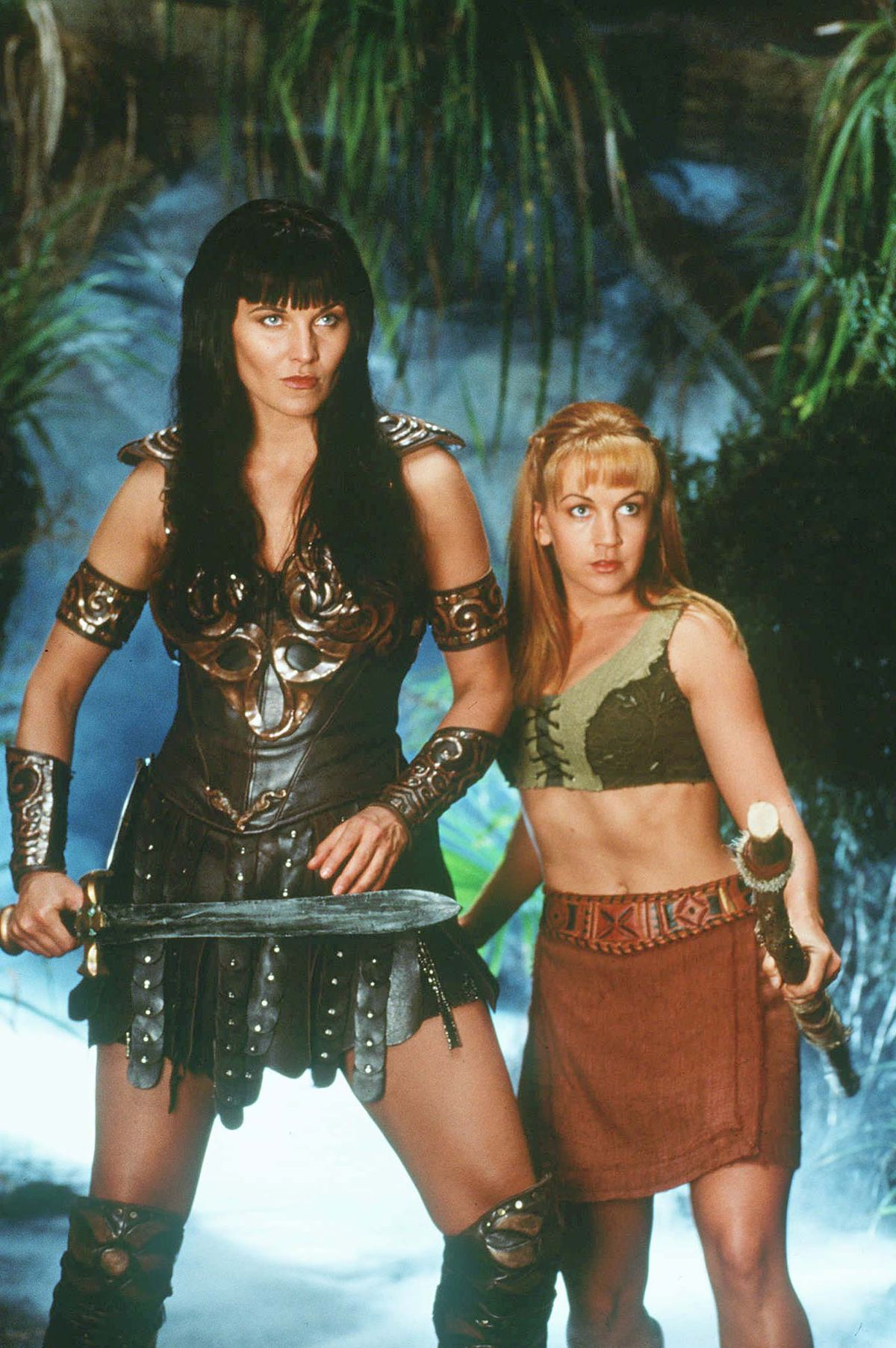 """Lucy Lawless as Xena poses with Renee O'Connor, who plays her sidekick Gabrielle in the syndicated television show """"Xena: Warrior Princess.''"""