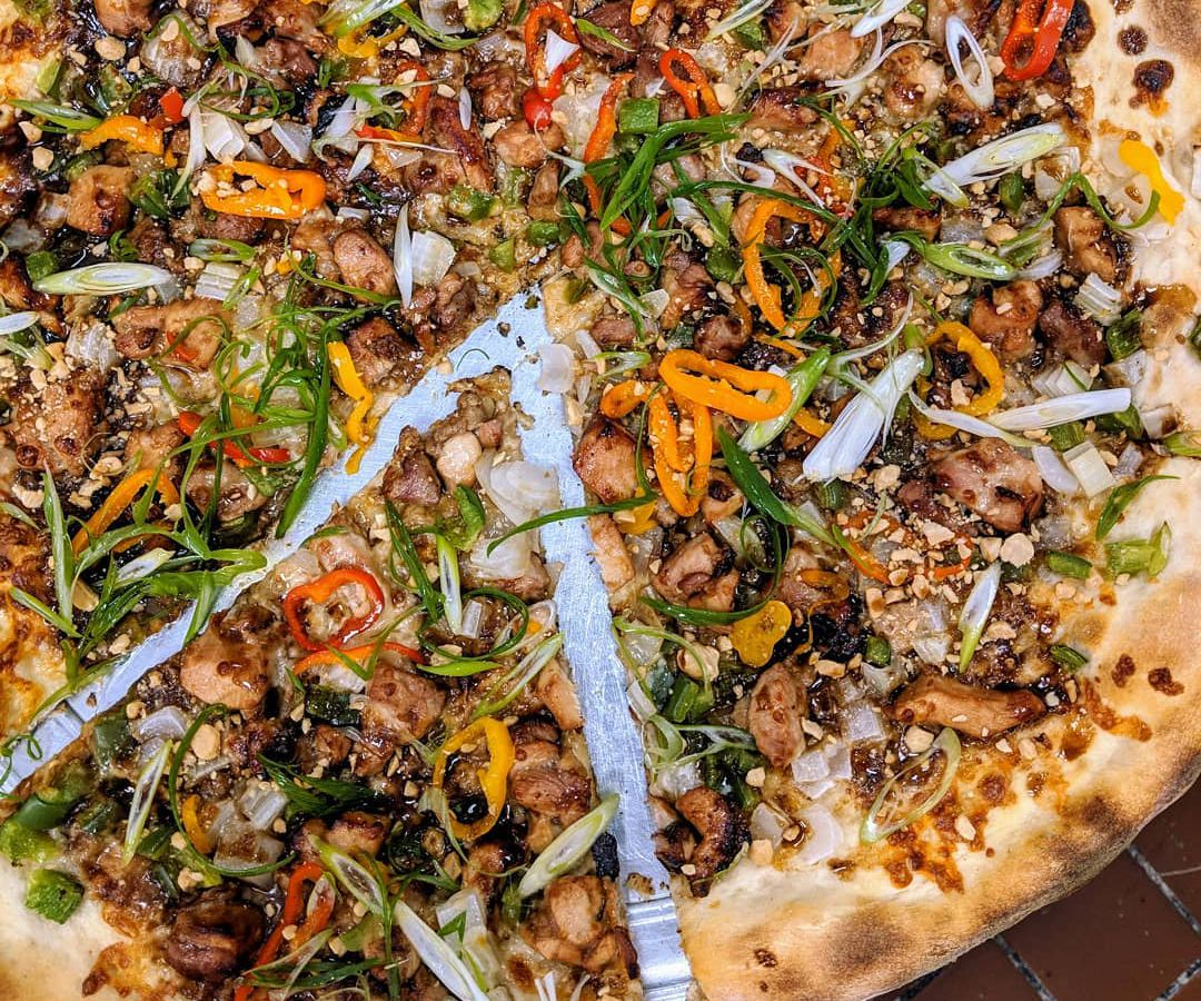 Kung pao chicken pizza at Dragon Pizza
