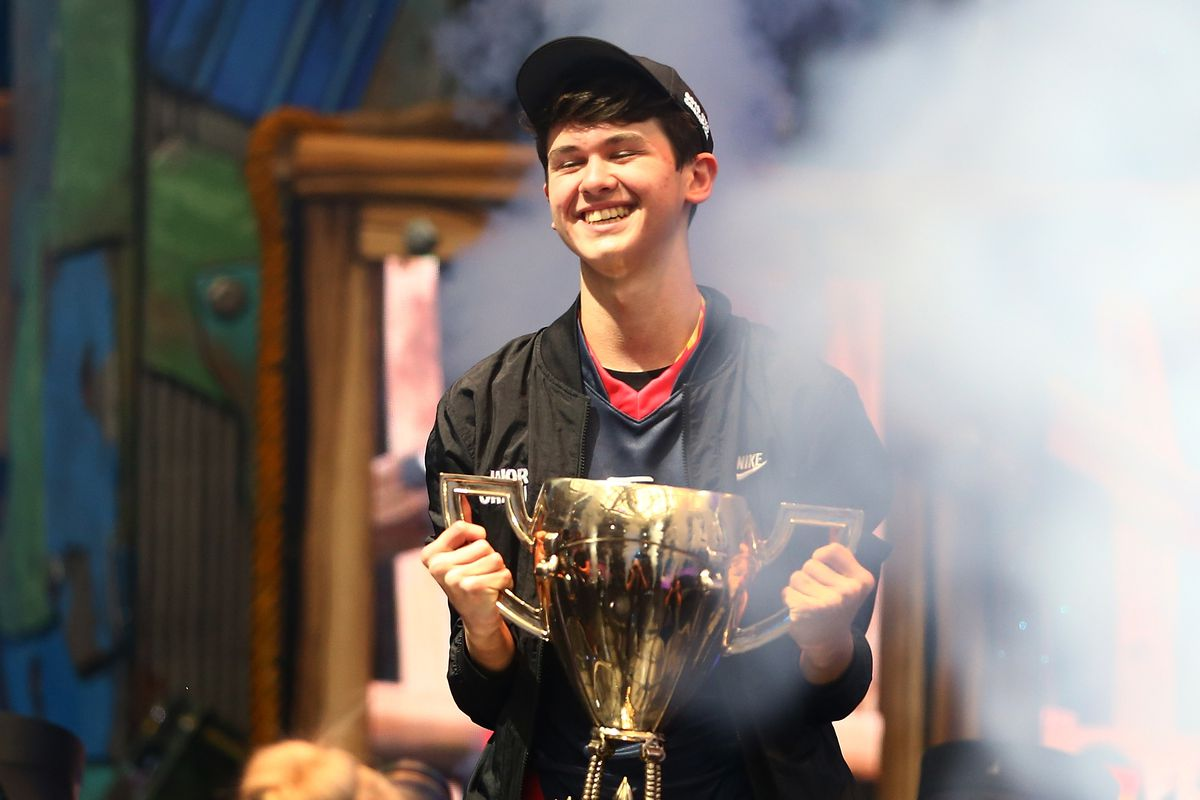 """16-year old Kyle """"Bugha"""" Giersdorf celebrates after winning the Fortnite World Cup solo final at Arthur Ashe Stadium, Jul. 28, 2019"""