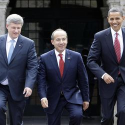 FILE - In this Aug. 10, 2009, file photo, President Barack Obama, right, Mexico's President Felipe Calderon, center, and Canada's Prime Minister Stephen Harper walk towards a stand for an official photo in Guadalajara, Mexico, for a North American summit. Obama is convening a summit with leaders from Mexico and Canada on Monday, April 2, 2012, that aims to boost a fragile recovery and grapple with thorny energy issues against a backdrop of painfully high gas prices. The session at the White House is a make-good for a planned meeting last November in Hawaii on the sidelines of the Asia-Pacific summit. Obama ended up meeting just with Harper when Mexican President Felipe Calderon's top deputy was killed in a helicopter crash.