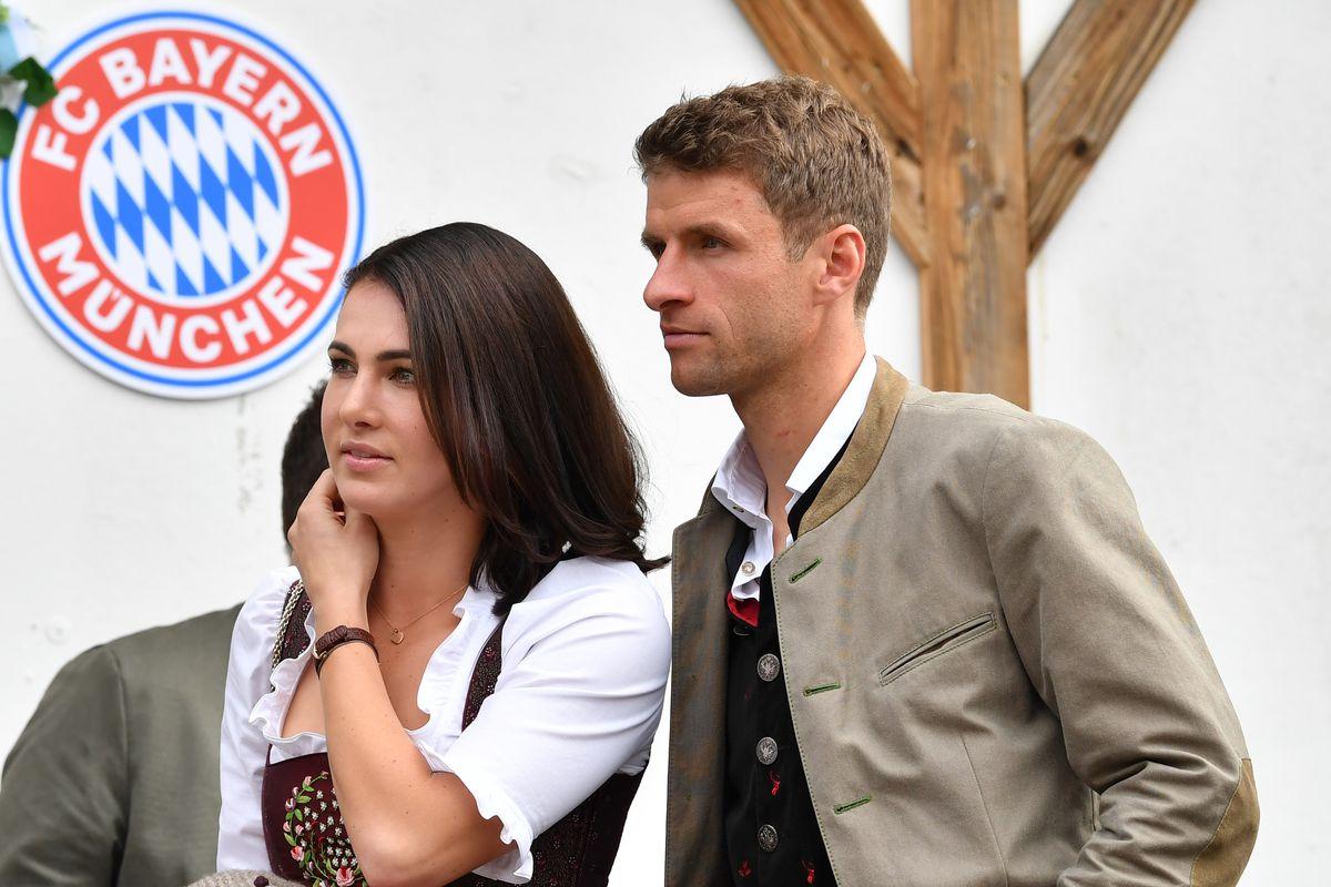 MUNICH, GERMANY - OCTOBER 07 : Thomas Mueller (R) and his wife Lisa Mueller attend the Oktoberfest beer festival at Kaefer Wiesenschaenke tent at Theresienwiese on October 7, 2018 in Munich, Germany.