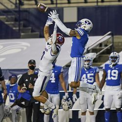 BYU defensive back Troy Warner, right, intercepts a pass intended for Louisiana Tech wide receiver Griffin Hebert, left, during the first half of an NCAA college football game Friday, Oct. 2, 2020, in Provo.