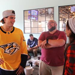 Kevin Fiala laughs with some fans from Tennessee Baptist Children's Home at Pinewood Social in Nashville.