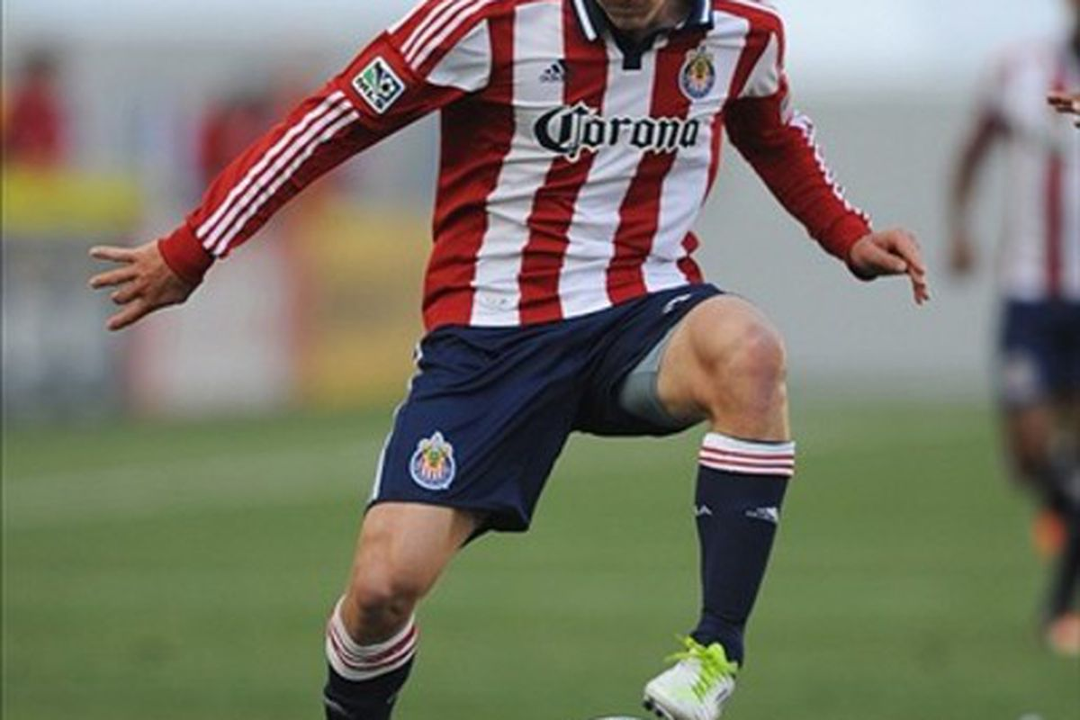Mar 11, 2012; Carson, CA, USA; Chivas USA midfielder Ben Zemanski (21) moves the ball down the field against the Houston Dynamo during the first half at the Home Depot Center. Mandatory Credit: Kelvin Kuo-US PRESSWIRE
