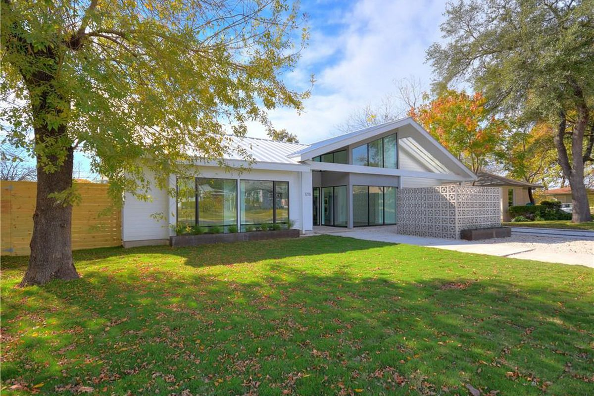 Midcentury modern style new home in austin is listed for for Modern houses for sale austin