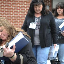 FILE -- A Feb. 23, 2012 file photo shows Gina Jones, left, wife of deceased Upper Big Branch coal miner Edward Dean Jones, exiting a meeting on the investigation of the Upper Big Branch disaster.  Jones and other family members Wednesday March 4, 2012 sued former Massey Energy chief Don Blankenship and eight others they hold responsible for the worst U.S. coal mining disaster in four decades.