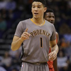 Phoenix Suns guard Devin Booker (1) in the first quarter during an NBA basketball game against the New Orleans Pelicans, Monday, Feb. 13, 2017, in Phoenix. (AP Photo/Rick Scuteri)