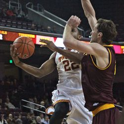 Jordan Bachynski comes over to try to block Byron Wesley.