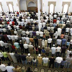 Men pray at the Khadeeja Islamic Center in West Valley City on Friday, June 29, 2012.