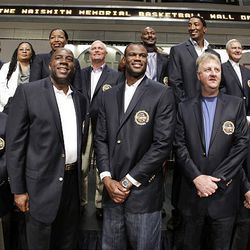 2010 basketball Hall of Fame inductees, including players from the 1992 U.S. Olympics Dream Team, at center from left, Magic Johnson, David Robinson and Larry Bird, pose at the Hall of Fame in Springfield, Mass., Friday.
