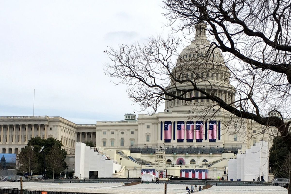 Flags drape the west side of the U.S. Capitol building as groups rehearse for Friday's inauguration.