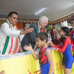 Elder D. Todd Christofferson, a member of the Quorum of Twelve Apostles for The Church of Jesus Christ of Latter-day Saints, center, greets students after their yoga performance during the 71st Independence Day celebrations at the MIT World Peace University in Pune, Maharashtra, India, on August 15, 2017.