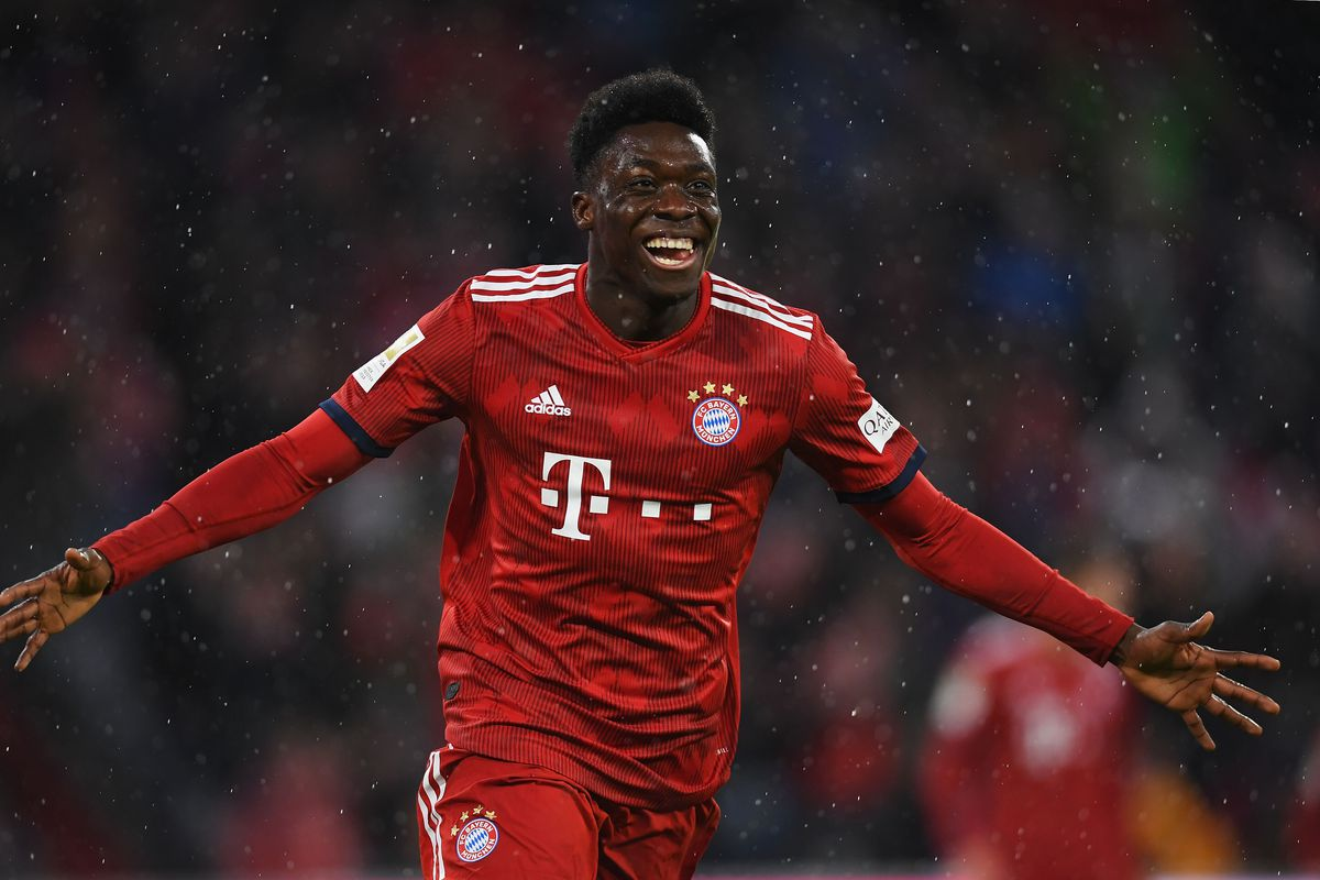 MUNICH, GERMANY - MARCH 17: Alphonso Davies of Bayern Munich celebrates scoring his teams sixth goal of the game during the Bundesliga match between FC Bayern Muenchen and 1. FSV Mainz 05 at Allianz Arena on March 17, 2019 in Munich, Germany.