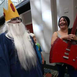 """Cory Wilson, as the Ice King from """"Adventure Time,"""" and Kristine Alexakos, as Marceline from """"Adventure Time,"""" wait in line to get into Utah's first Comic Con at the Salt Palace Convention Center in Salt Lake City on Thursday, Sept. 5, 2013."""