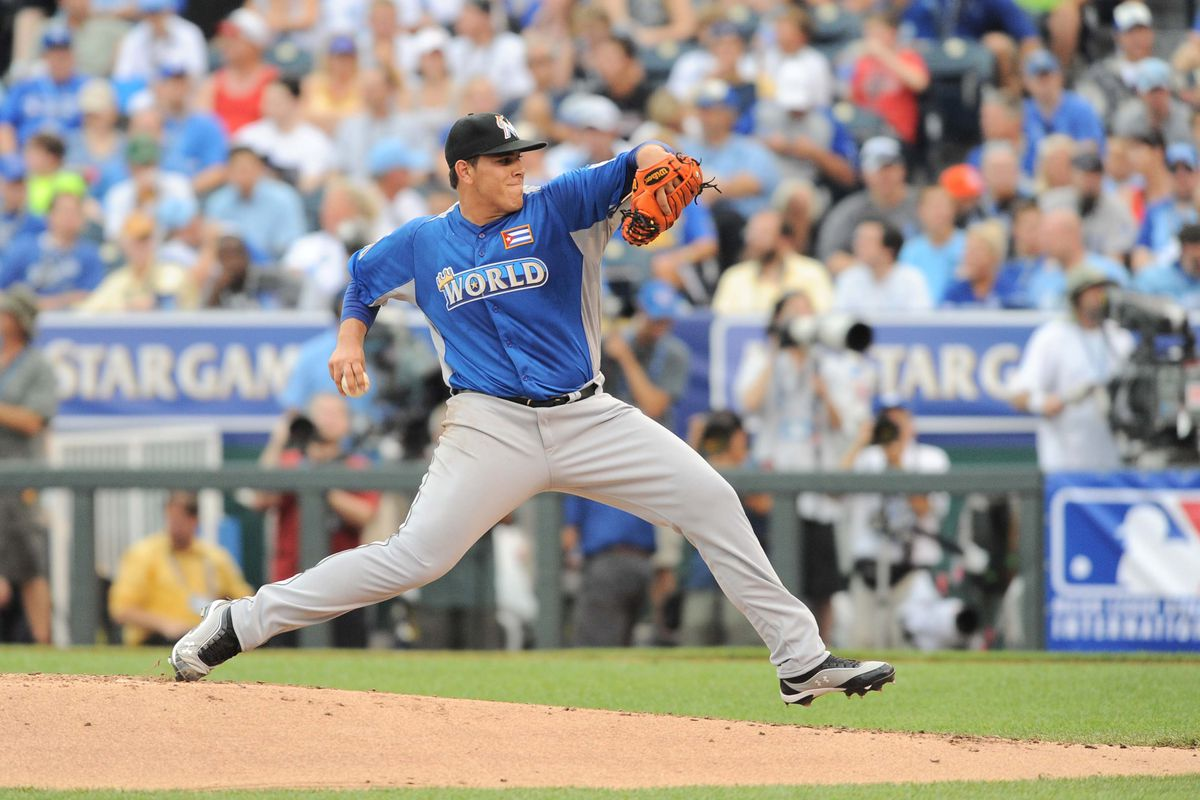 July 9, 2012; Kansas City, MO, USA; World team pitcher Jose Fernandez (16) delivers a pitch in the second inning of the 2012 All Star Futures Game at Kauffman Stadium. Mandatory Credit: Denny Medley-US PRESSWIRE